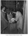 Japanese Americans packing belongings, probably in Seattle, 1942