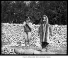 Igorrote child and Inuit child at Alaska-Yukon-Pacific Exposition, Seattle, 1909.