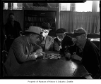 Men playing checkers at Compass Siloah Mission, Seattle, 1938