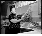 Ruby Chow in the kitchen, probably in Seattle, 1960