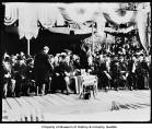 President William Howard Taft and others seated on stage at event, Alaska-Yukon-Pacific...