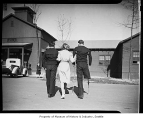Red Cross nurse walking with two injured servicemen, 1943