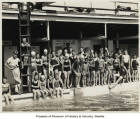 Helene Madison and young swimmers at Natatorium in Wenatchee, Washington, June 29, 1930