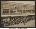 Exterior of the Bon Marché with crowd awaiting Santa Claus's arrival, Christmas 1902