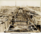 Reinforced steel cable pipe frame in trench, ca. 1928-1930
