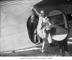 Helene Madison and coach Ray Daughters leaving airplane, Seattle, March 26, 1930