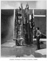 Sculptor James FitzGerald with bronze fountain, Seattle World's Fair, 1962