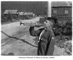 Young bugler at a Civilian Conservation Corps camp, 1939