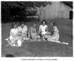 Five young women playing cards on the lawn, Kelly's Ranch, 1940