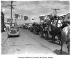 Horse-drawn carriages in a Washington State Golden Jubilee parade, Enumclaw, August 12, 1939