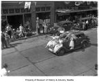 Five young women ride on a car in the Golden Jubilee Parade, Enumclaw, August 1939