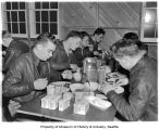 Army Air Corps Dawn Patrol pilots eating a meal, Paine Field, Everett, 1942