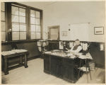 Man seated at desk, Supply Laundry Company, Seattle, 1917