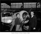 Seattle pilots Frederic and Laura Brunton beside an airplane, probably in Seattle, 1939