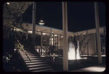 Exterior of the Playhouse Theater with fountain at night, Seattle World's Fair, 1962