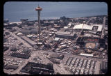 Aerial view, looking west, of the Space Needle and Seattle World's Fair grounds with Elliott Bay,...