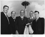 Officials in front of Space Needle, Seattle World's Fair, ca. 1962