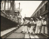 Women casting off lines for the first voyage of the President Grant, Seattle, June 12, 1926