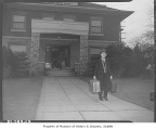Japanese consul Yuki Sato leaving residence after Pearl Harbor attack, Seattle, 1941