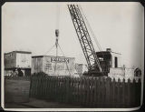 Crane moving container at Dollar Company wharf, Shanghai, China, ca. 1926