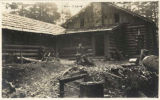 Charles Hazlehurst in front of rear side of Mountaineers lodge, Rockdale, Washington, September 5,...