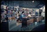 Two librarians in the American Library Association Exhibit, Seattle World's Fair, 1962