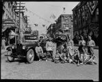 Chinese dance group with decorated car on King Street, ca. 1921