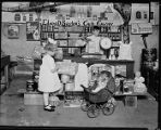Children playing grocery store, ca. 1921