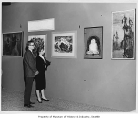 Couple viewing Fine Arts exhibit, Seattle World's Fair, 1962