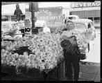 Onion seller at Pike Place Market, July 5, 1941