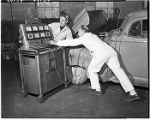 Auto mechanics using Sun automotive tester, 1949