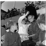 Children with a Royal Canadian Mounted Policeman during Canada Week, Seattle World's Fair,...