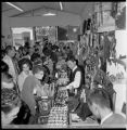 Interior of a souvenir shop filled with fairgoers on closing day, Seattle World's Fair, October...