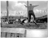 Logrollers at a lumberjack show, Seattle World's Fair, 1962