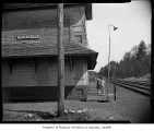Children outside abandoned railroad depot, Ravensdale, April 14, 1955