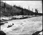 Shooting White Horse Rapids in a canoe, 1905