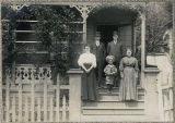 Family on the porch of a mill house at Port Blakely, 1909