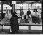 Buying lettuce at the Pike Place Market, January 1924