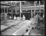 Men grading and sorting boards at a lumber mill, 1948
