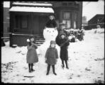 Children and their champion snowman, November 20, 1921