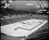 Interior of the Washington State Coliseum (now Key Arena) with ice hockey and basketball floors...