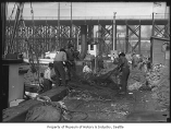 Fishermen checking nets at  Fisherman's Terminal, Seattle, ca. 1920