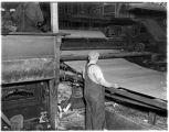Mill worker at a rolling machine in a plywood mill, July  1937