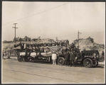 Band riding on a fire truck during the Golden Potlatch parade, Seattle, ca. 1913