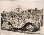 Women in lower-decorated automobile in Golden Potlatch parade, Seattle, ca. 1913