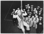 Cadet in a bosun's chair tying off rope in a class at the Puget Sound Naval Academy, 1940