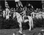 Woman on horseback dressed as Joan of Arc at Seattle's Independence Day celebration, July 5, 1920