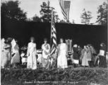 "Man in ancient Greek dress holding American flag at the ""Pageant of Democracy,"" Woodland..."