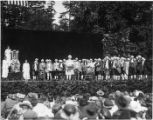 "Performers in colonial dress and others at the ""Pageant of Democracy"" in Woodland Park,..."