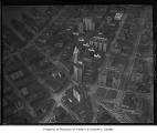 Navy biplanes flying over downtown Seattle, 1936